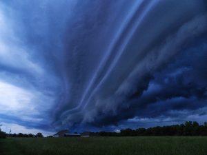 deep-blue-storm-clouds-over-farmhouse